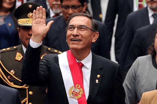 Peruvian president Martin Vizcarra waving